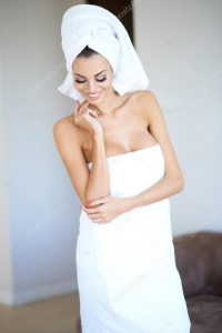 depositphotos_52143349-stock-photo-smiling-woman-wearing-white-bath